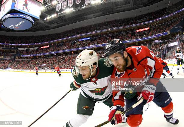 Minnesota Wild defenseman Anthony Bitetto fights for a loose puck with Washington Capitals right wing Tom Wilson on March 22 at the Capital One Arena...