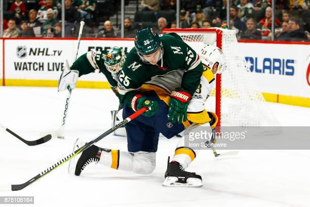 Minnesota Wild defenseman Jonas Brodin collides with Nashville Predators center Nick Bonino in the 1st period during the Central Division game...