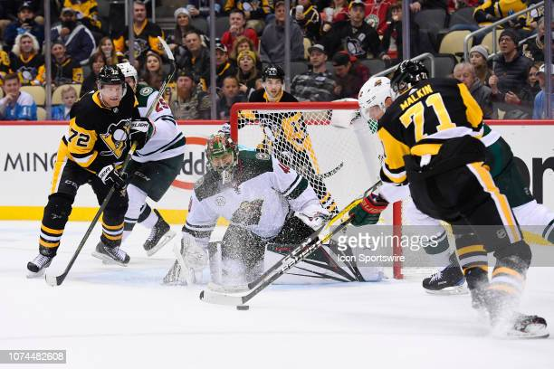 Minnesota Wild Goalie Devan Dubnyk keeps the puck out of the net with Pittsburgh Penguins Right Wing Patric Hornqvist and Pittsburgh Penguins Center...