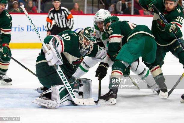 Minnesota Wild goalie Devan Dubnyk makes a save during the preseason game between the Dallas Stars and the Minnesota Wild on September 30 2017 at...