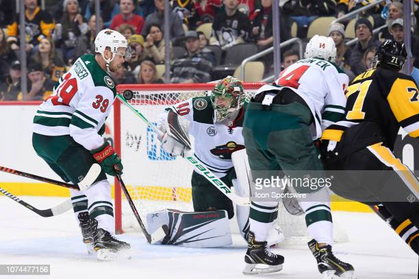 Minnesota Wild Goalie Devan Dubnyk makes a save on Pittsburgh Penguins Center Evgeni Malkin during the first period in the NHL game between the...