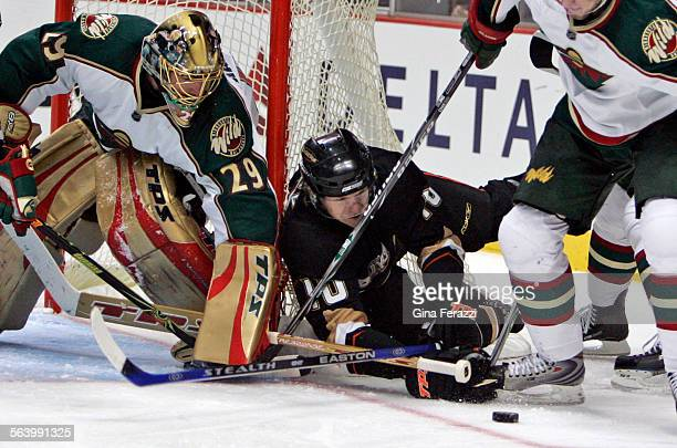 Minnesota Wild goalie Josh Harding uses the top part of his stick to keep the puck away from Ducks Corey Perry in the third period at Honda Center...