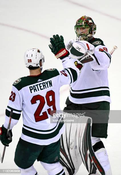 Minnesota Wild goaltender Devan Dubnyk is congratulated by defenseman Greg Pateryn following the 21 win against the Washington Capitals on March 22...