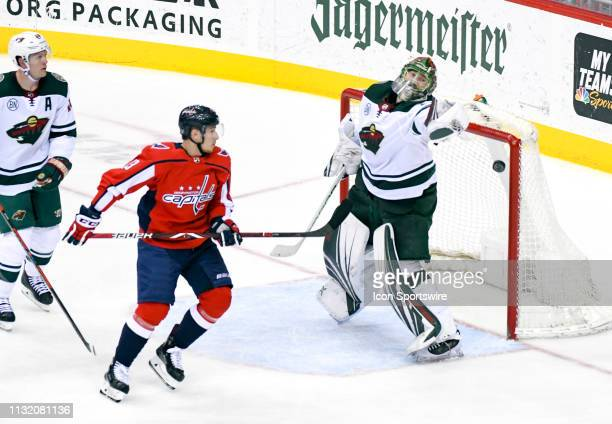Minnesota Wild goaltender Devan Dubnyk reaches for puck in the air as Washington Capitals left wing Jakub Vrana skates in during the third period on...