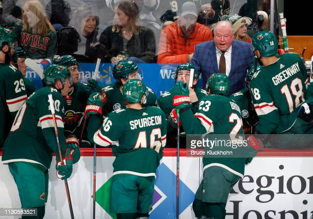 Minnesota Wild head coach Bruce Boudreau talks to his players during a game with the Dallas Stars at Xcel Energy Center on March 14 2019 in St Paul...
