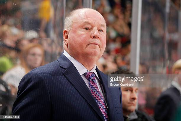 Minnesota Wild head coach Bruce Boudreau watches from the bench during the game against the Toronto Maple Leafs on October 20 2016 at the Xcel Energy...