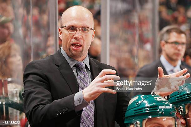 Minnesota Wild head coach Mike Yeo instructs his players during the game against the Calgary Flames on March 27 2015 at the Xcel Energy Center in St...