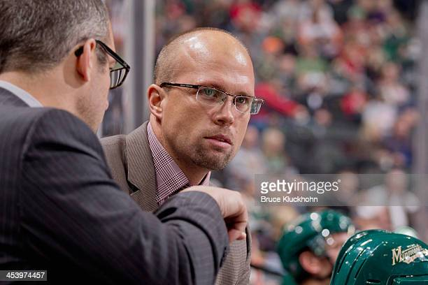 Minnesota Wild Head Coach Mike Yeo talks with his assistant coaches during the game against the Philadelphia Flyers on December 2 2013 at the Xcel...