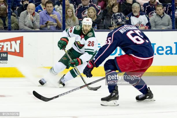 Minnesota Wild left wing Daniel Winnik changes direction as Columbus Blue Jackets defenseman Markus Nutivaara pursues in the second period of a game...
