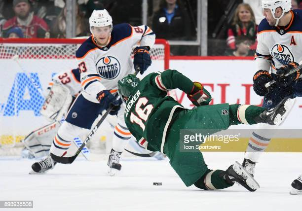 Minnesota Wild Left Wing Jason Zucker takes a shot on goal as he falls to the ice during a NHL game between the Minnesota Wild and Edmonton Oilers on...