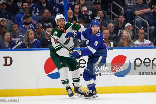 Minnesota Wild left wing Jordan Greenway and Tampa Bay Lightning center Tyler Johnson skate in the 1st period of the NHL game between the Minnesota...