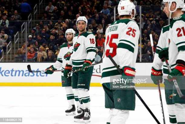 Minnesota Wild left wing Jordan Greenway checks with teammates before a face off during a game between the Boston Bruins and the Minnesota Wild on...