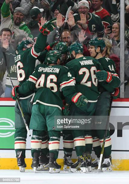 Minnesota Wild Left Wing Marcus Foligno is hugged by Minnesota Wild Defenceman Nick Seeler Minnesota Wild Defenceman Jared Spurgeon Minnesota Wild...