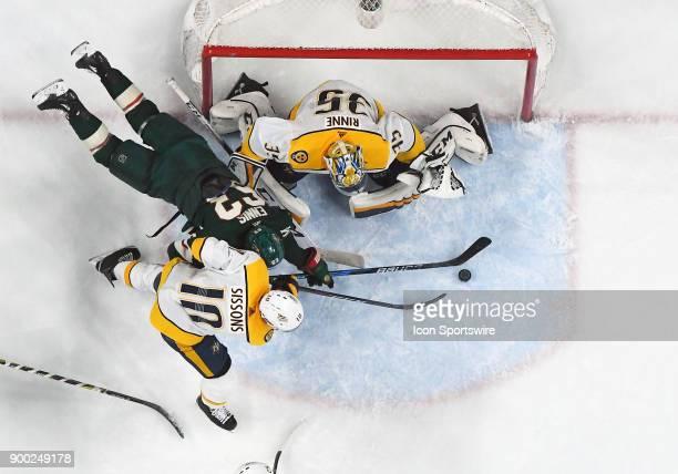 Minnesota Wild Left Wing Tyler Ennis is stopped on this attempt by Nashville Predators Goalie Pekka Rinne and Nashville Predators Winger Colton...