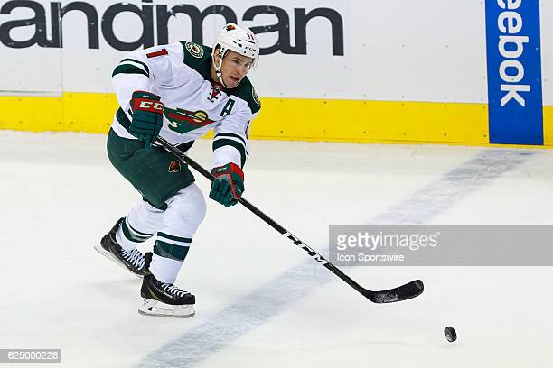 Minnesota Wild Left Wing Zach Parise crosses the blue line and makes a pass during the NHL game between the Minnesota Wild and Dallas Stars on...
