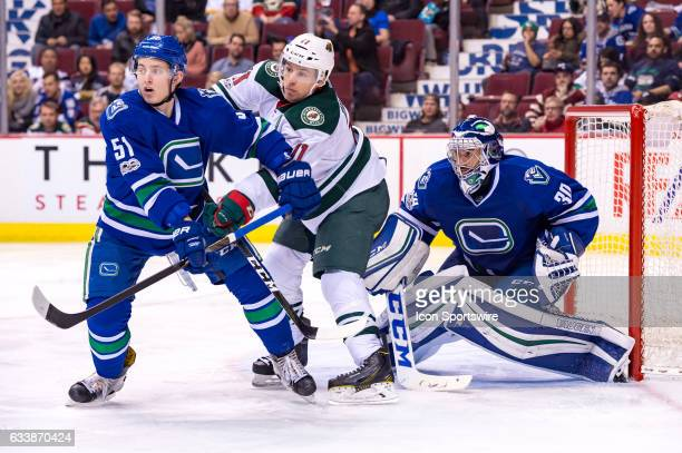 Minnesota Wild Left Wing Zach Parise screens Goalie Ryan Miller as Vancouver Canucks Defenceman Troy Stecher defends during their NHL game at Rogers...