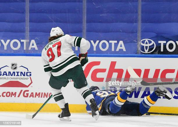 Minnesota Wild leftwing Kirill Kaprizov looks on as St. Louis Blues right wing Vladimir Tarasenko falls to the ice while playing the puck during an...