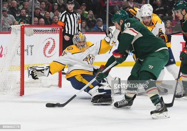 Minnesota Wild Right Wing Chris Stewart tries to beat a sticklers Nashville Predators Goalie Pekka Rinne during a NHL game between the Minnesota Wild...