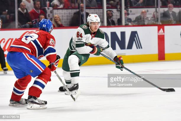 Minnesota Wild Right Wing Mikael Granlund stretches his stick to gain control of the puck facing Montreal Canadiens Defenceman Victor Mete during the...