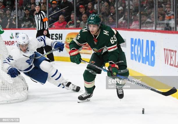 Minnesota Wild Right Wing Tyler Ennis skates with the puck as Toronto Maple Leafs Defenceman Nikita Zaitsev gives chase during a NHL game between the...
