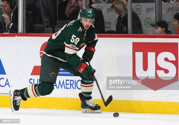 Minnesota Wild Right Wing Zack Mitchell skates the puck up ice during a NHL game between the Minnesota Wild and Toronto Maple Leafs on December 14...