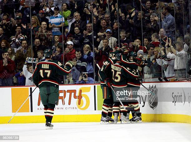 Minnesota Wild teammates celebrate a first period goal by Marian Gaborik against the Edmonton Oilers on November 23, 2005 at the Xcel Energy Center...