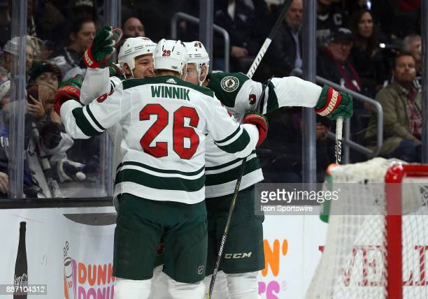 Minnesota Wild winger Daniel Winnik and Minnesota Wild right wing Chris Stewart celebrate with Minnesota Wild center Charlie Coyle after Coyle scores...