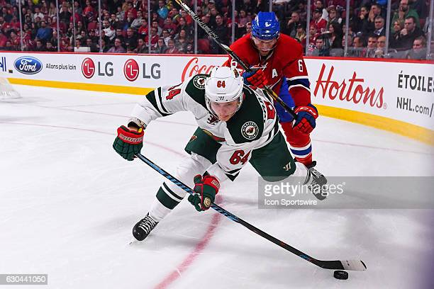 Minnesota Wild Winger Mikael Granlund barely controlling the puck followed closely by Montreal Canadiens Defenceman Shea Weber during the Minnesota...