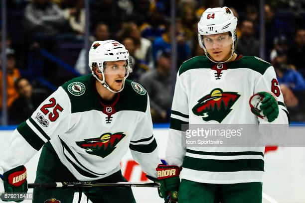Minnesota Wild's Jonas Brodin left and Mikael Granlund right discuss strategy before a faceoff during the third period of an NHL hockey game The St...