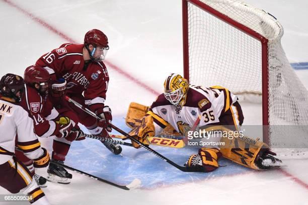 MinnesotaDuluth Bulldogs goalie Hunter Miska covers the puck in front of Harvard Crimson forward Ryan Donato in the second period of an NCAA Frozen...