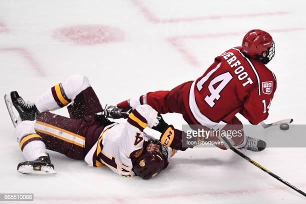 MinnesotaDuluth Bulldogs wing Alex Iafallo trips Harvard Crimson forward Alexander Kerfoot in the second period of an NCAA Frozen Four semifinal game...