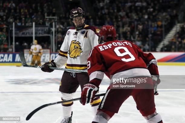 MinnesotaDuluth Bulldogs wing Karson Kuhlman laughs with Harvard Crimson forward Luke Esposito during a NCAA National Semifinal College Hockey game...