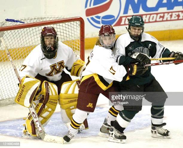Minnesota's Becky Wacker center tries to keep Dartmouth's Lydia Wheatley right away from Minnesota goalie Jody Horak during the NCAA 2004 Women's...