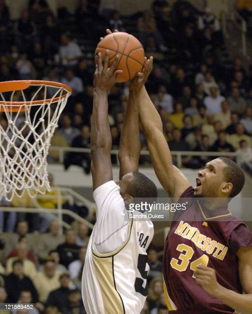 Minnesota's Damian Johnson blocks the shot of Keaton Grant during Purdue's 6647 win over Minnesota in Mackey Arena West Lafayette Indiana on February...