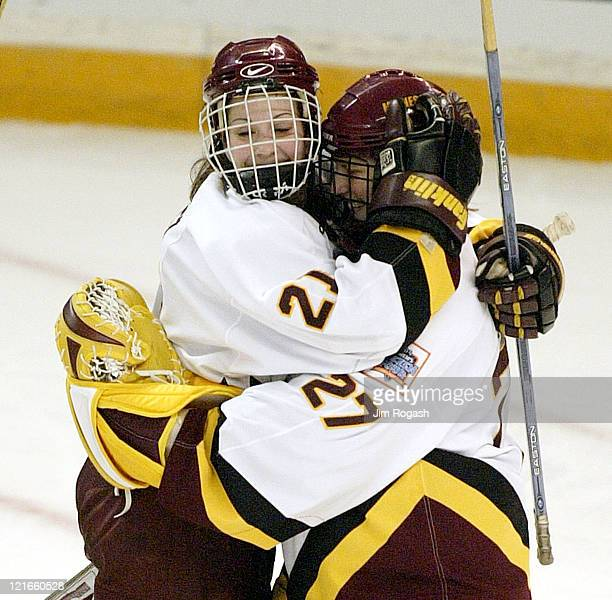 Minnesota's goalie Jody Horak, right, is hugged by Allie Sanchez, left after winning the game against Dartmouth during the NCAA 2004 Women's Frozen...