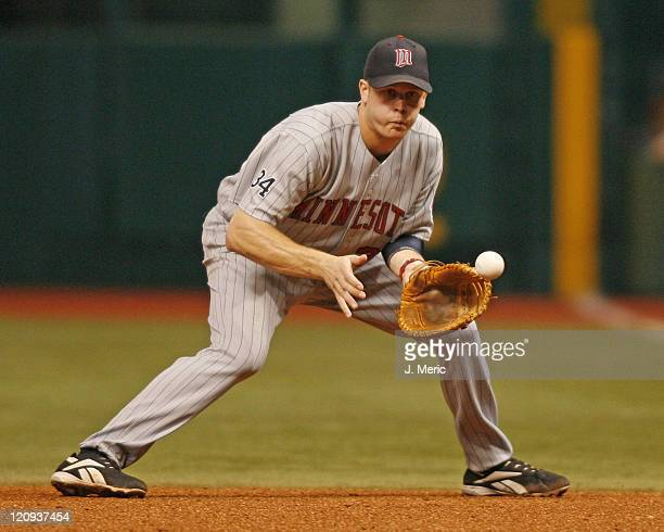 Minnesota's Justin Morneau makes this play at first during Wednesday night's game against Tampa Bay at Tropicana Field in St. Petersburg, Florida on...