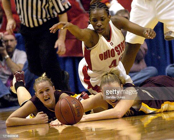 Minnesota's Kelly Roysland and Jamie Broback watch the ball roll away asTamarah Riley looks on in Minnesota's upset win over Ohio State in the Big...