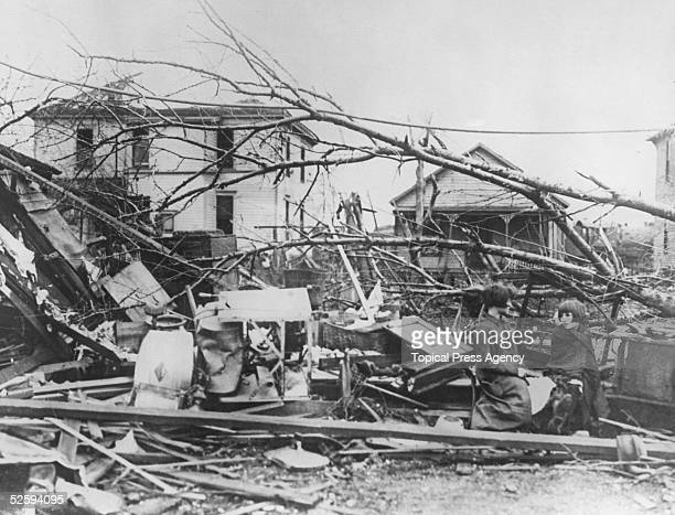 Minnie and Rose Hawkins sit amongst the wreckage of their home in Murphysboro Illinois in the wake of the tristate tornado March 1925 The tornado...