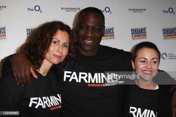 Minnie Driver Adewale AkinnuoyeAgbaje and Jaime Winstone attend a photocall for 'Farming' at Sundance London 2012 at The Cineworld O2 on April 27...