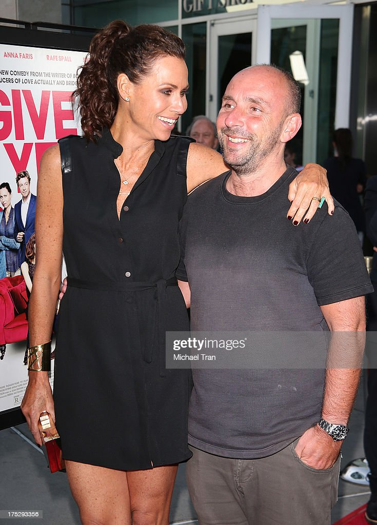 Minnie Driver (L) and Dan Mazer arrive at a Los Angeles special screening of 'I Give It A Year' held at ArcLight Hollywood on August 1, 2013 in Hollywood, California.