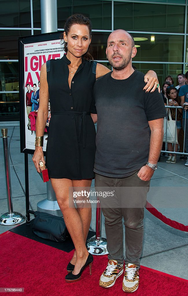 Minnie Driver and Dan Mazer arrive at the Screening Of Magnolia Pictures' 'I Give It A Year' at ArcLight Hollywood on August 1, 2013 in Hollywood, California.