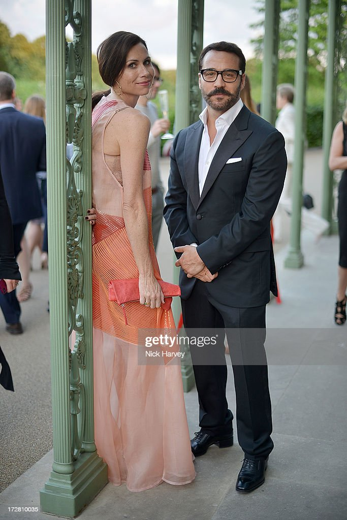 Minnie Driver and Jeremy Piven attends the launch party for the Fashion Rules exhibition, a collection of dresses worn by HRH Queen Elizabeth II, Princess Margaret and Diana, Princess of Wales at Kensington Palace on July 4, 2013 in London, England.