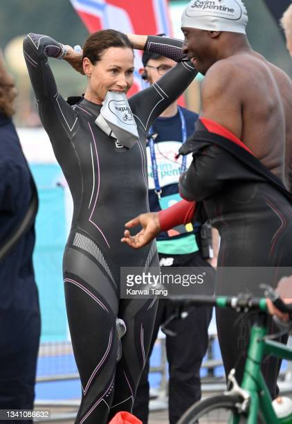 Minnie Driver and Linford Christie during the Children With Cancer UK Swim Serpentine in Hyde Park on September 18, 2021 in London, England.