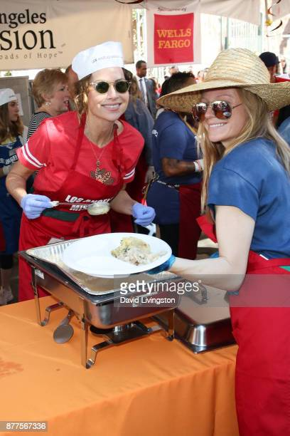 Minnie Driver and Marci Miller are seen at the Los Angeles Mission Thanksgiving Meal for the homeless at the Los Angeles Mission on November 22 2017...