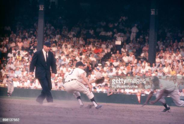 Minnie Minoso of the Cleveland Indians is caught stealing as Coot Veal of the Detroit Tigers receives the ball as umpire Hank Soar moves into...
