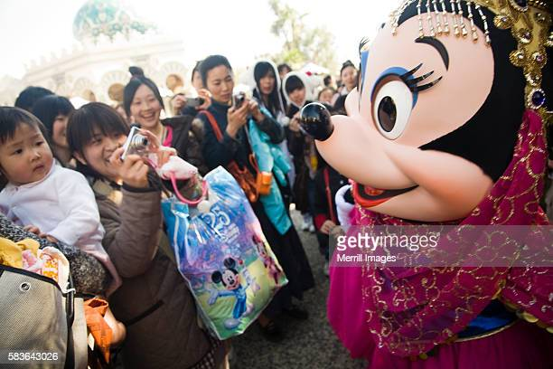 minnie mouse and crowd of fans at disneysea resort - disney world stock pictures, royalty-free photos & images