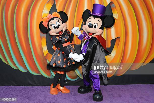 Minnie Mouse and Mickey Mouse attend Disney's VIP halloween event at Disney Consumer Products Campus on October 1 2014 in Glendale California