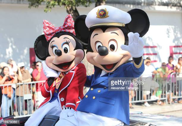 Minnie Mouse and Mickey Mouse participate in the 43rd Annual Three Kings Day Parade on January 20 2013 in Miami Florida