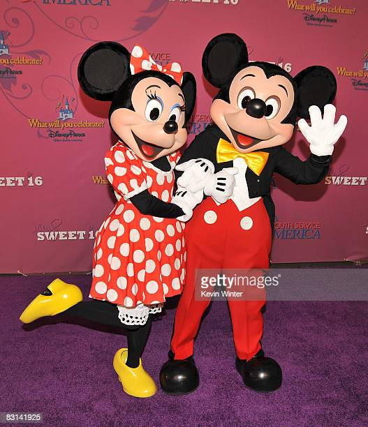 Minnie Mouse and Mickey Mouse pose at Miley Cyrus' Sweet 16 birthday celebration benefiting Youth Service America at Disneyland on October 5 2008 in...