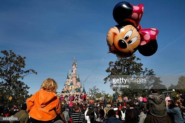 Minnie Mouse balloon floats in front of Cinderella's Castle at Disneyland Resort Paris the amusement park run by Eurodisney in MarnelaVallee near...